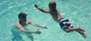 T Jumps to Daddy in the pool